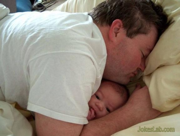 funny daddy sleeping with baby