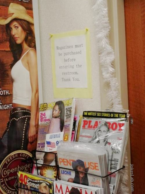 funny sign, magazines must be purchased before bringing into toilet